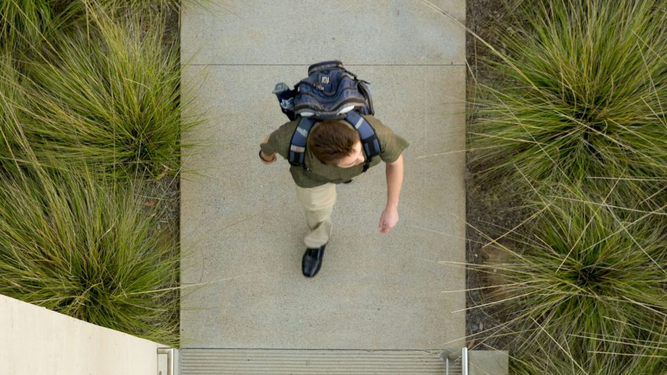 Student walking on path
